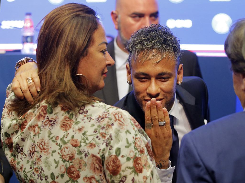 Brazilian soccer star Neymar blows a kiss during a press conference in Paris Friday, Aug. 4, 2017. Neymar arrived in Paris on Friday the day after he ...
