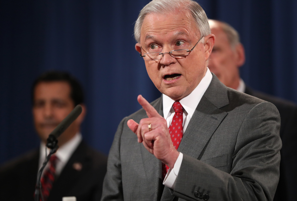 Attorney General Jeff Sessions, accompanied by, from left, National Counterintelligence and Security Center Director William Evanina, Director of Nati...