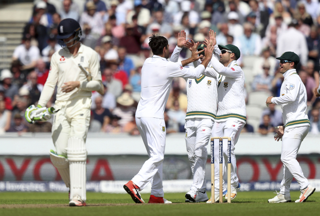 South Africa's Duanne Olivier, second left, celebrates dismissing England's Keaton Jennings, left, with team-mates during the Fourth Test at Emirates ...