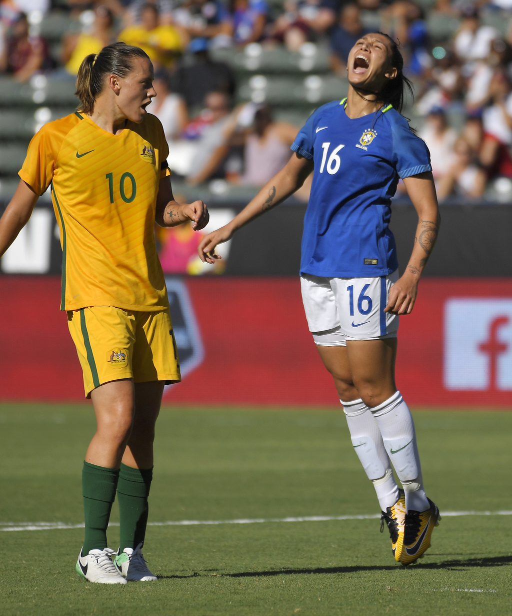 Brazil's Bia Zaneratto, right, reacts after missing a shot as Australia's Emily Van Egmond watches during the first half of a Tournament of Nations so...