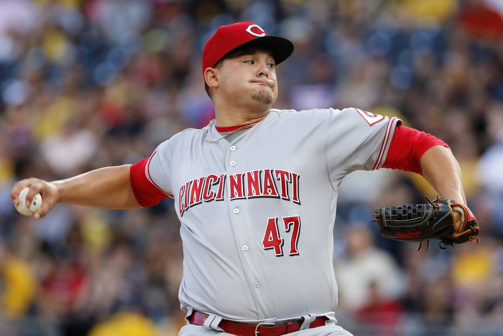 Cincinnati Reds starting pitcher Sal Romano delivers during the first inning of the team's baseball game against the Pittsburgh Pirates in Pittsburgh,...