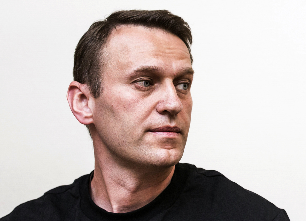 Russian opposition leader Alexei Navalny listens in the court room in Moscow, Russia, Thursday, Aug. 3, 2017. The court ruled Thursday that Navalny an...