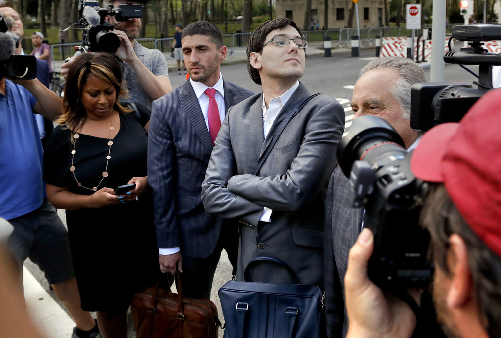 Former pharmaceutical company CEO Martin Shkreli stands at an intersection after leaving federal court with his legal team, Thursday, Aug. 3, 2017, in...