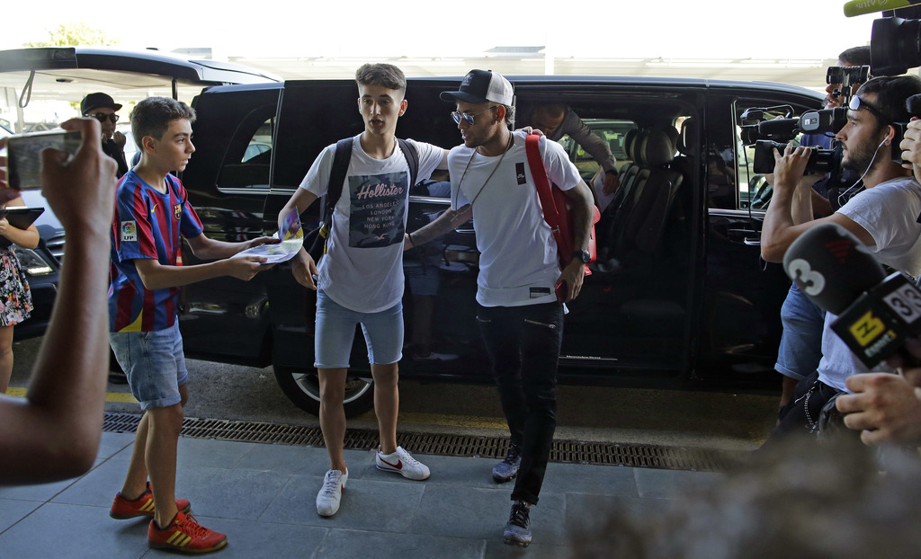 Soccer player Neymar arrives at the Barcelona airport in Prat de Llobregat, Spain, Friday, Aug. 4, 2017. The Brazil star became the most expensive pla...