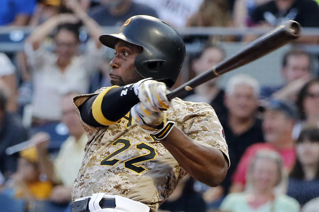 Pittsburgh Pirates' Andrew McCutchen watches his RBI single off Cincinnati Reds starting pitcher Sal Romano during the third inning of a baseball game...