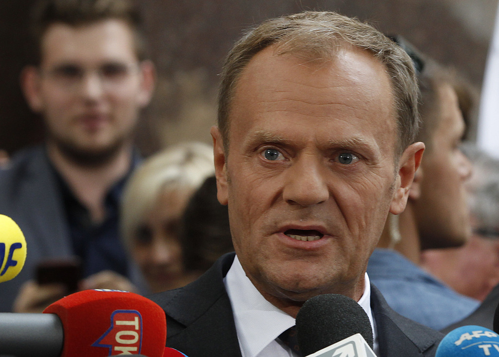 President of the European Council Donald Tusk speaks to the media outside the prosecutor's office in Warsaw, Poland, Thursday, Aug. 3, 2017.  Polish i...