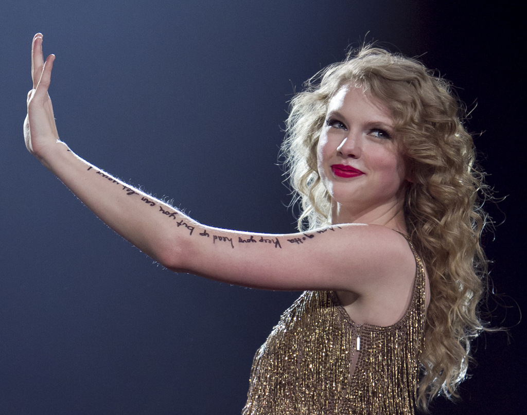 "FILE - In this May 27, 2011, file photo, singer Taylor Swift performs her song ""Story of Us"", as she kicks off her Speak Now North American tour in Om..."