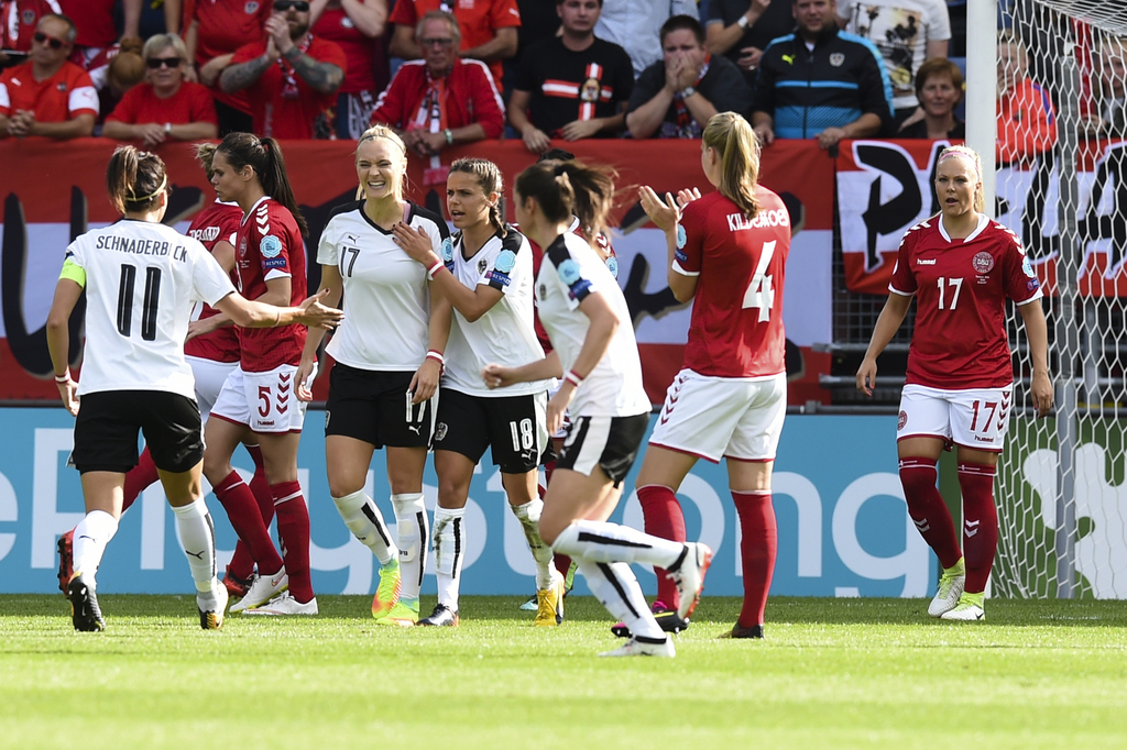 Austria's Sarah Puntigam number 17 center left, reacts after she failed to score by penalty during the Women's Euro 2017 semifinal soccer match betwee...