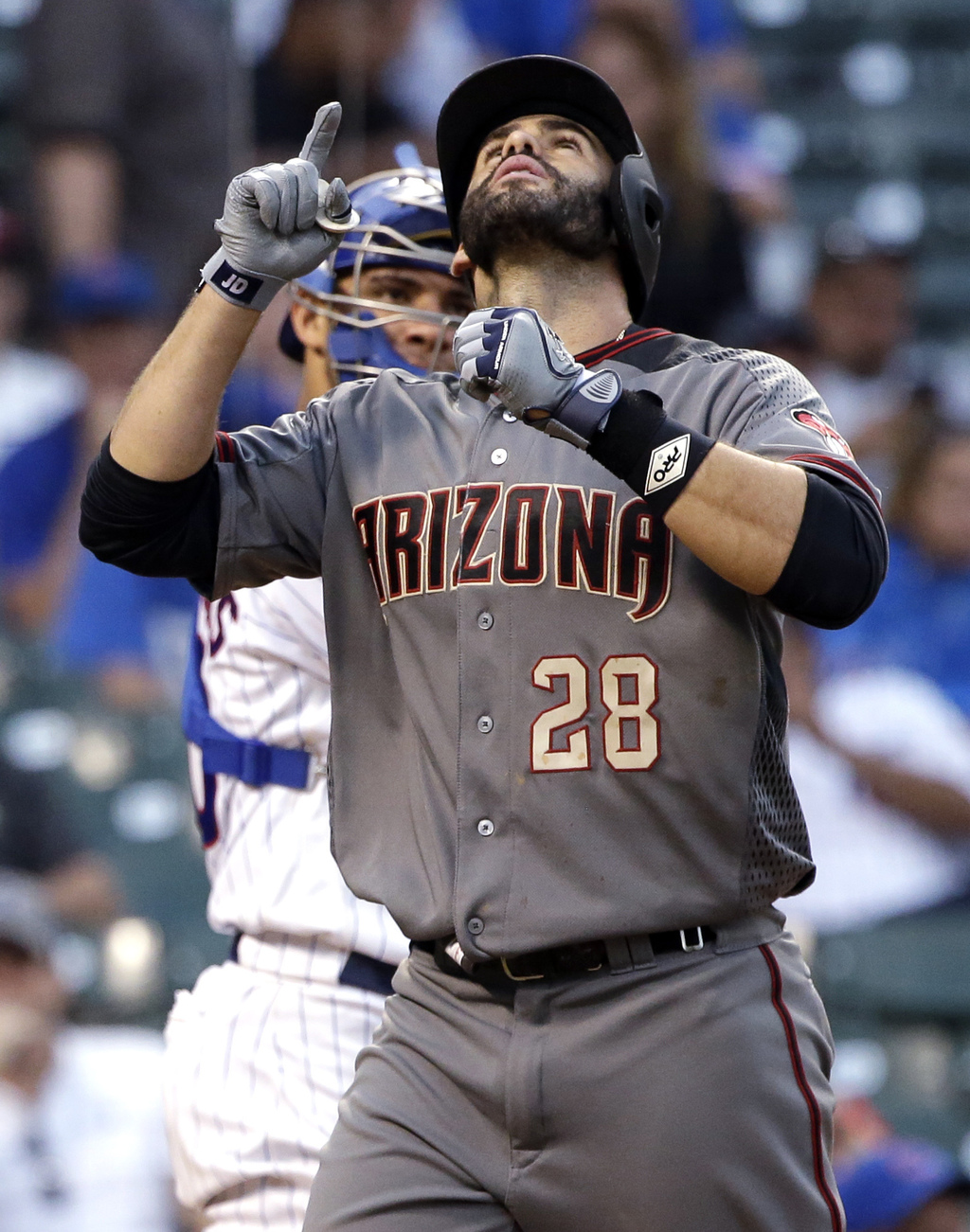 Arizona Diamondbacks' J.D. Martinez celebrates after hitting a solo home run against the Chicago Cubs during the ninth inning of a baseball game Thurs...