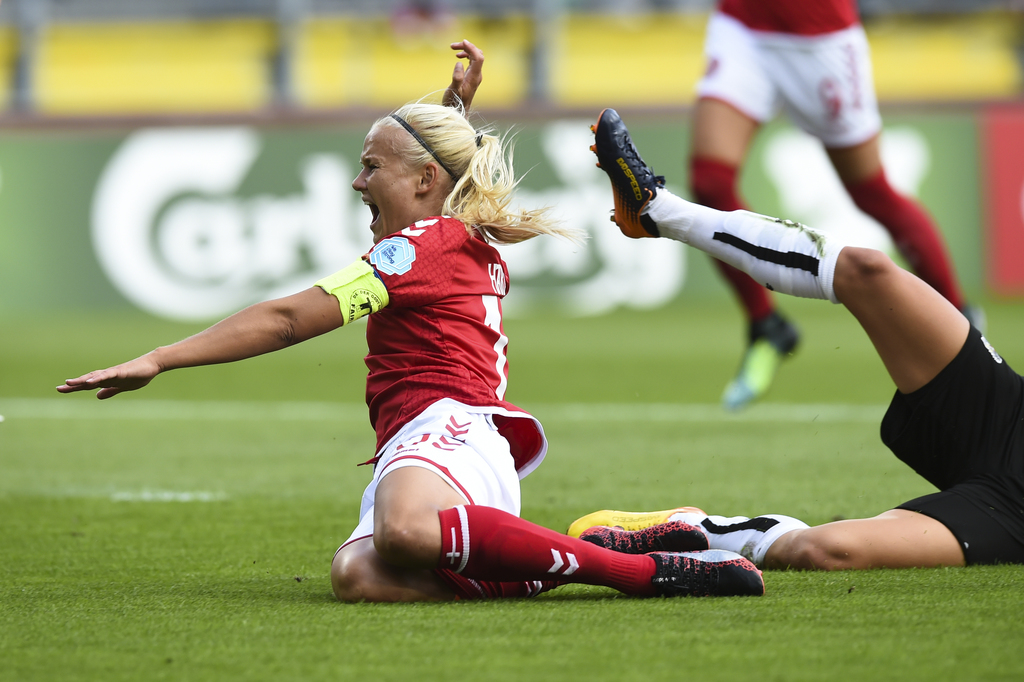 Denmark's Pernille Harder tumbles on the field during the Women's Euro 2017 semifinal soccer match between Denmark and Austria in Breda, the Netherlan...