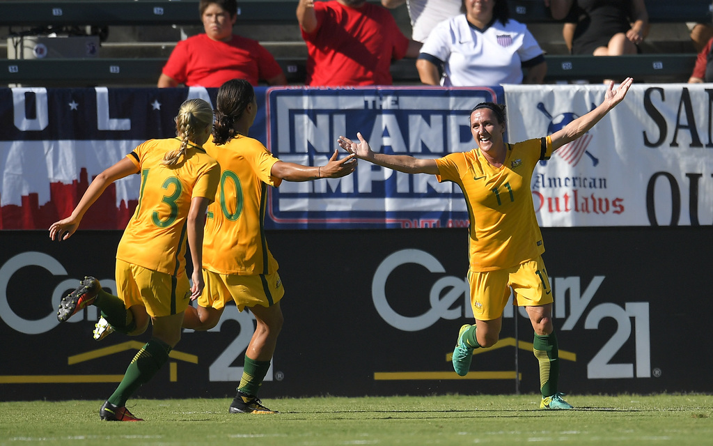 Australia's Lisa De Vanna, right, celebrates with teammates Temeka Butt, left, and Sam Kerr after scoring during the first half of the team's Tourname...