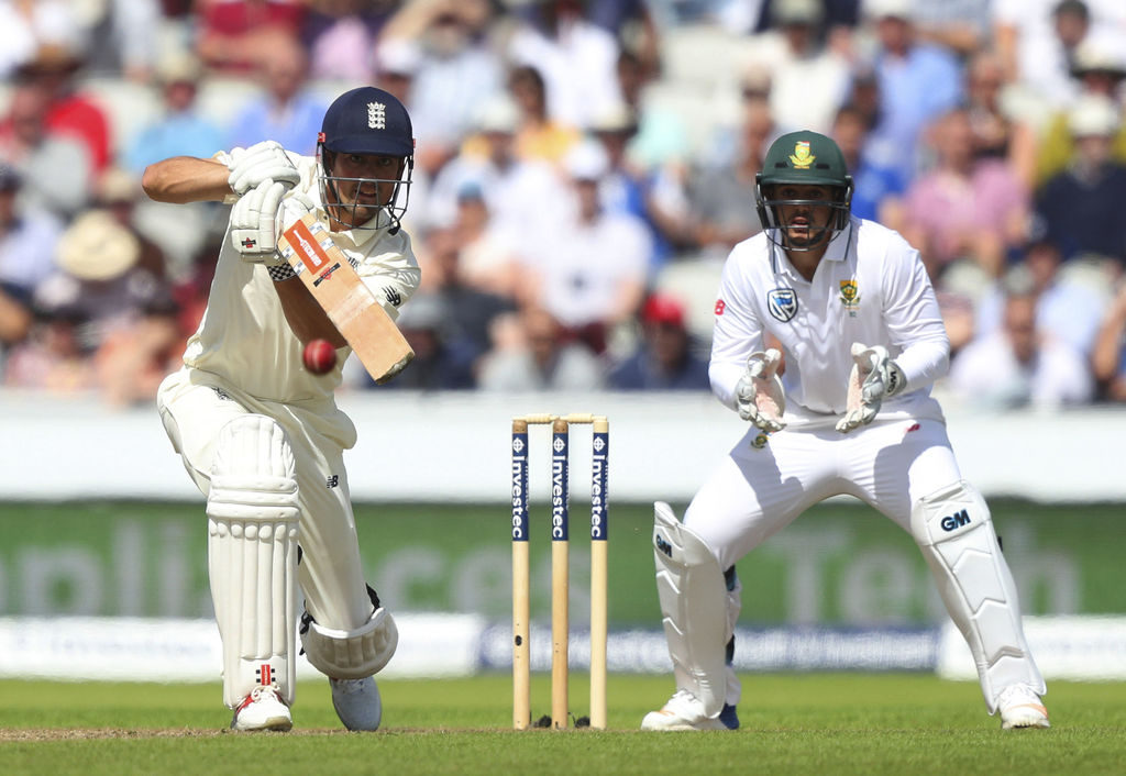 England's Alastair Cook, left, bats watched by South Africa's Quinton de Kock during the fourth cricket Test match between England and South Africa at...