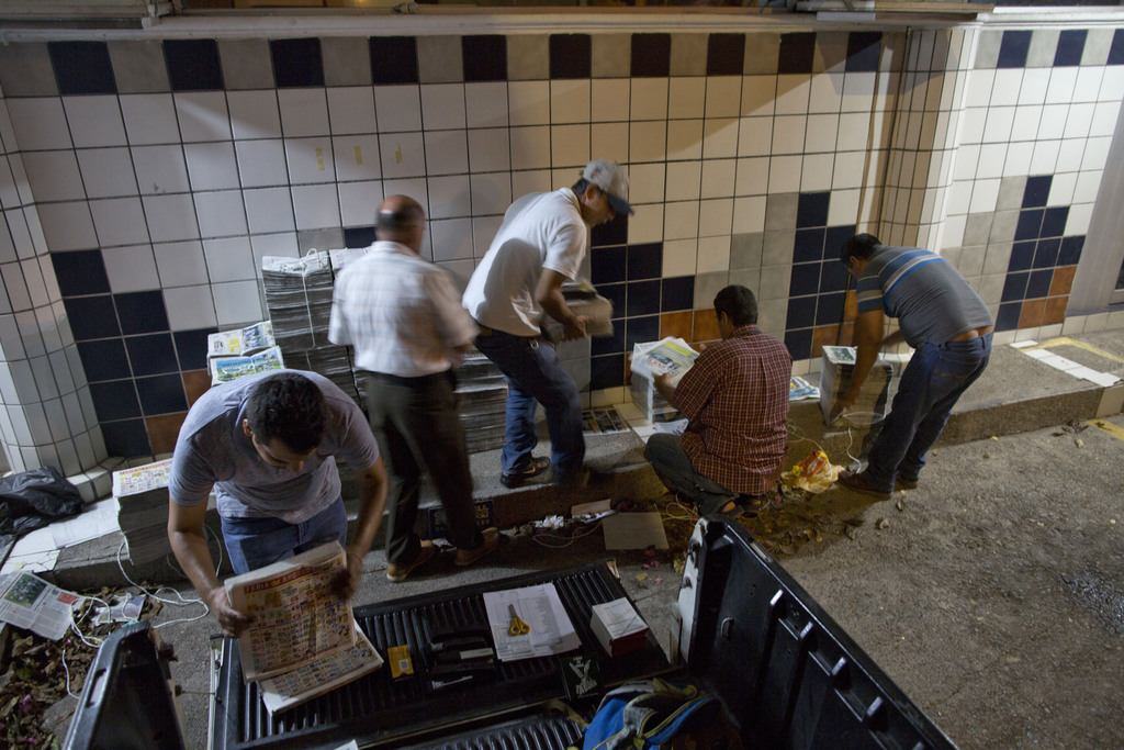 In this July 3, 2017 photo, drivers prepare to distribute Riodoce newspapers in Culiacan, Sinaloa state, Mexico. Riodoce, a weekly publication, was cr...