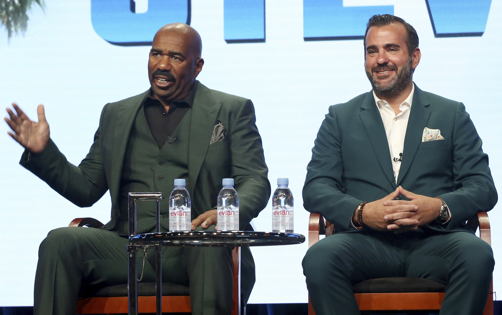 """Host/executive producer Steve Harvey, left, and executive producer Shane Farley participate in the """"Steve"""" panel during the NBC Television Critics Ass..."""