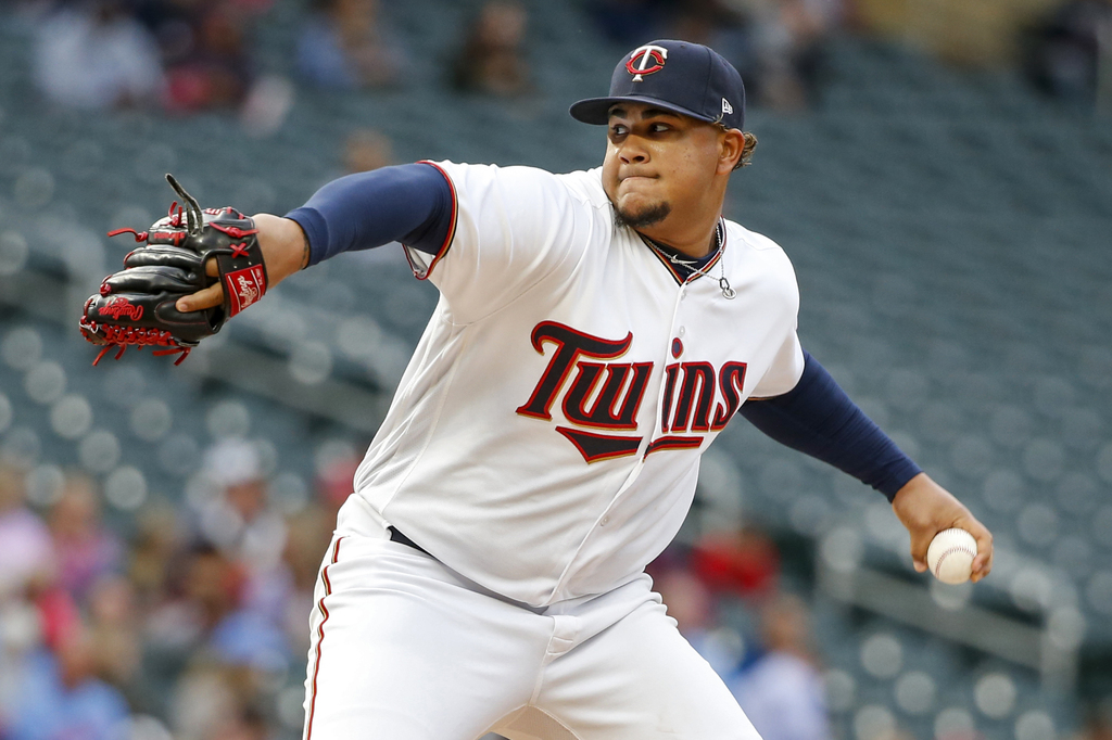 Minnesota Twins starting pitcher Adalberto Mejia throws to the Texas Rangers in the first inning of a baseball game Thursday, Aug. 3, 2017, in Minneap...