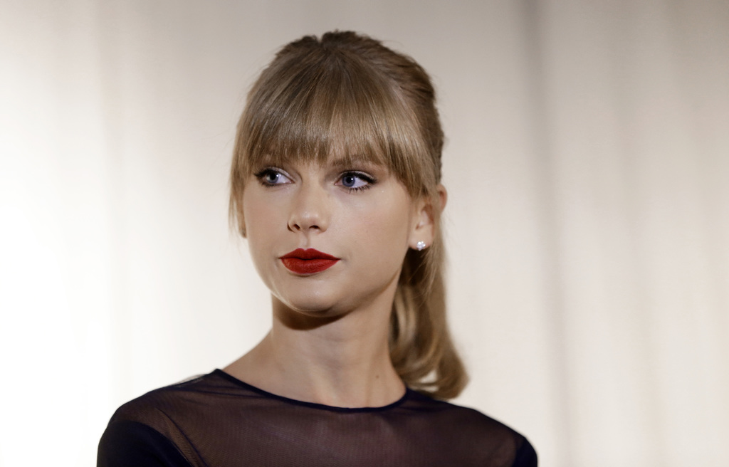 FILE - In this Oct. 12, 2103 file photo, Taylor Swift appears at the Country Music Hall of Fame and Museum in Nashville, Tenn. David Mueller, a former...