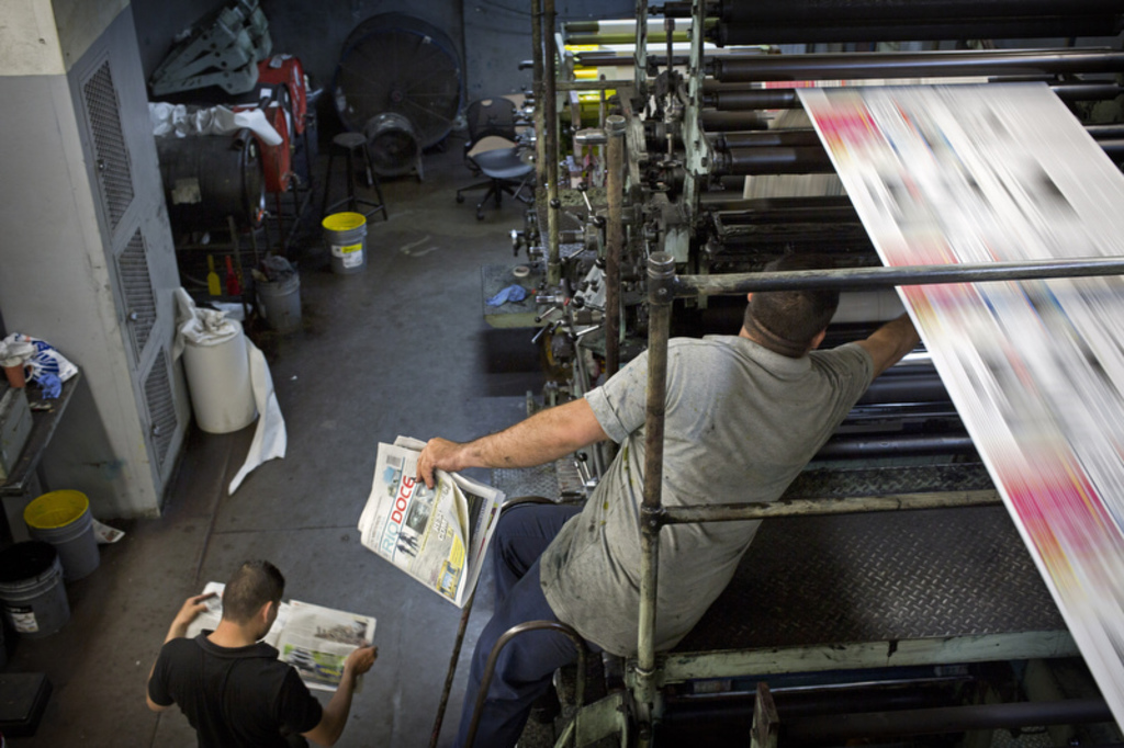 In this late, July 1, 2017 photo, workers print the latest issue of the weekly newspaper Riodoce, in Culiacan, Sinaloa state, Mexico. Journalists at R...