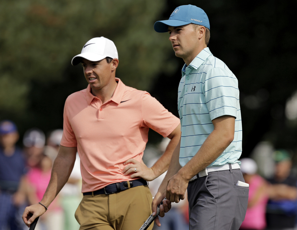 Jordan Spieth, right, talks with Rory McIlroy, from Northern Ireland, on the first hole during the second round of the Bridgestone Invitational golf t...