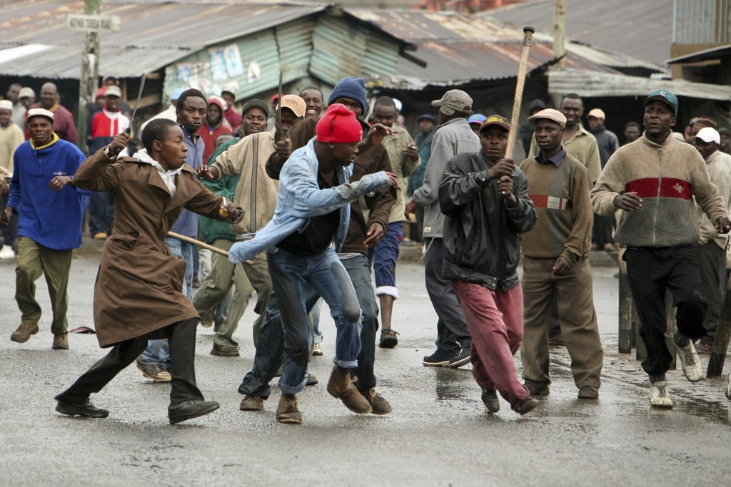 In this photo taken Sunday, Jan. 20, 2008, a Luo opposition supporter is hacked with machetes by Kikuyu supporters of then-president Mwai Kibaki, shor...