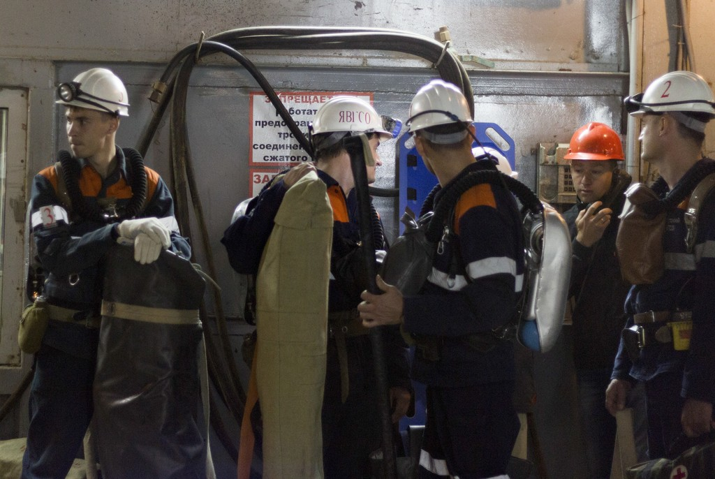 In this handout photo taken on Friday Aug. 4, 2017 released by ALROSA diamond mining company shows a group of rescuers at the the Mir diamond mine, on...