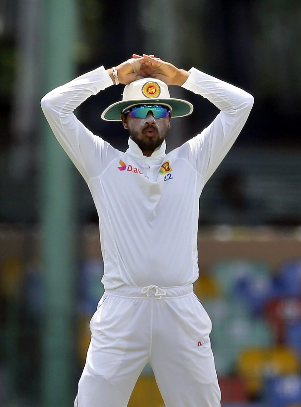 Sri Lanka's captain Dinesh Chandimal reacts to a delivery during their second cricket test match against India in Colombo, Sri Lanka, Friday, Aug. 4, ...