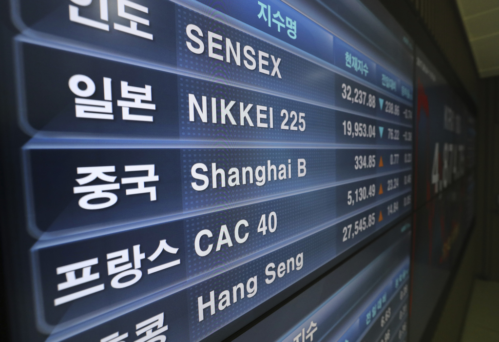 The indexes of the global markets are shown on a huge screen at the Korea Exchange in Seoul, South Korea, Friday, Aug. 4, 2017. Most Asian stock marke...