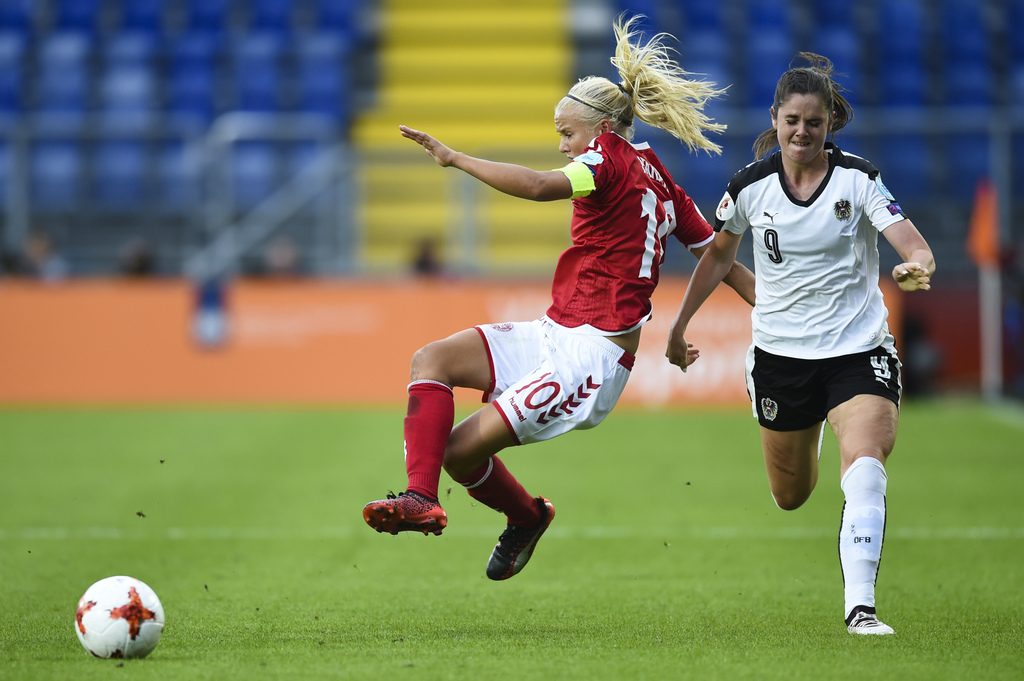 Denmark's Pernille Harder, left, and Austria's Sarah Zadrazil challenge for the ball during the Women's Euro 2017 semifinal soccer match between Denma...