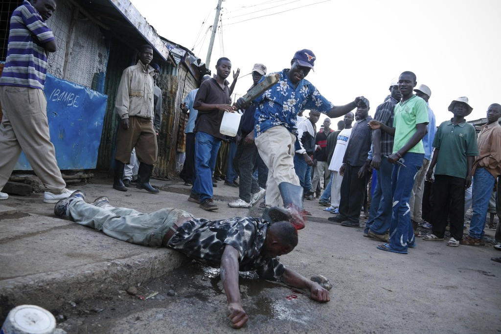 In this photo taken Wednesday, Jan. 16, 2008, a man is attacked by a mob on the street, and later died, after responding to a greeting and in doing so...
