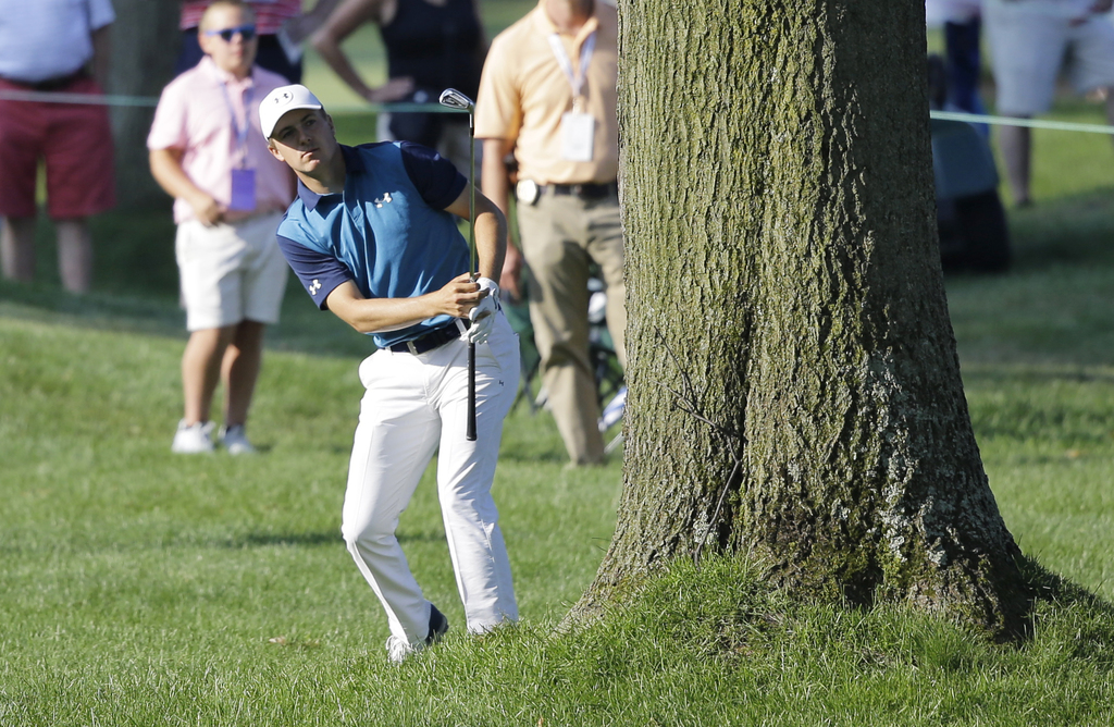 Jordan Spieth hits to the 13th green during the first round of the Bridgestone Invitational golf tournament at Firestone Country Club, Thursday, Aug. ...