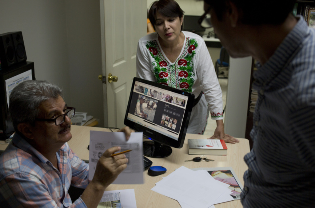 In this June 30, 2017 photo, Ismail Bojorquez, 60, co-founder and director of Riodoce, speaks with editors Andres Villareal and Judith Valenzuela as t...