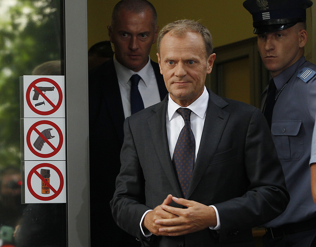 President of the European Council Donald Tusk leaves the prosecutor's office in Warsaw, Poland, Thursday, Aug. 3, 2017.  Polish investigators question...