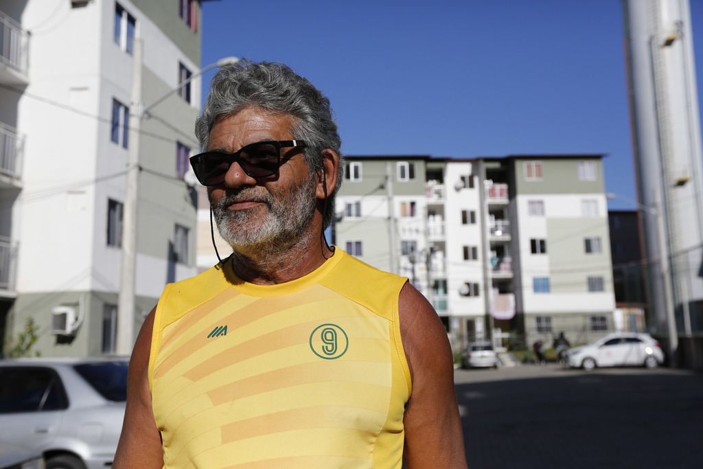 In this July 20, 2017, photo, Jorge Ramos stands in front of the Parque Carioca social housing complex in Rio de Janeiro, Brazil. Ramos exchanged his ...