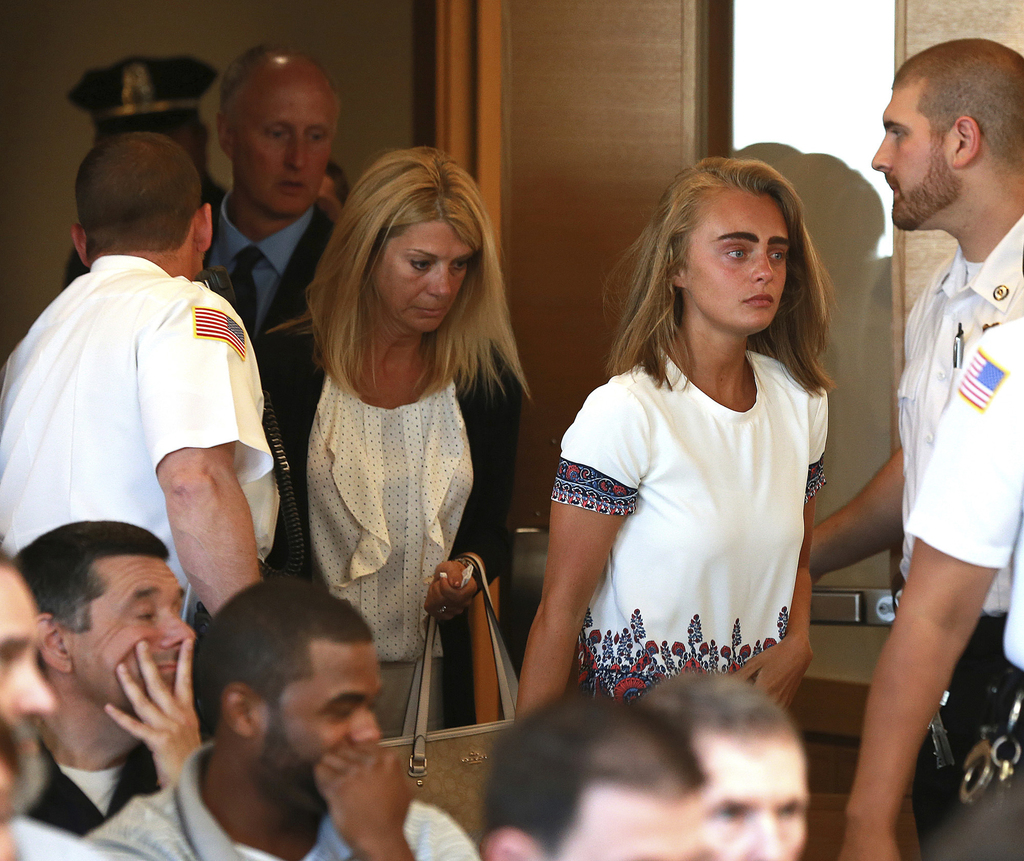 Followed by her parents, Michelle Carter arrives for her sentencing at a courtroom in Taunton, Mass., Thursday, Aug. 3, 2017, for involuntary manslaug...