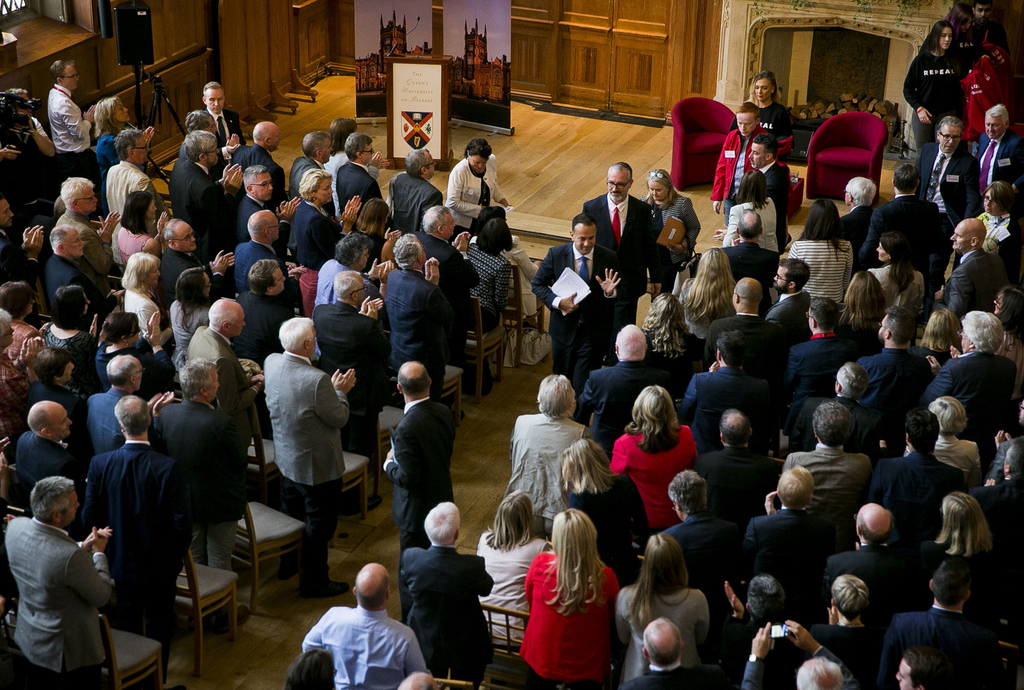 Irish Prime Minister Leo Varadkar, centre, acknowledges the applause of the audience after making a speech at Queen's University in Belfast, Northern ...