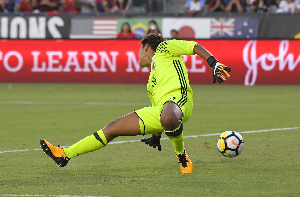 Japan goalkeeper Ayaka Yamashita gives up a goal to United States' Megan Rapinoe during the first half of Tournament of Nations soccer match, Thursday...
