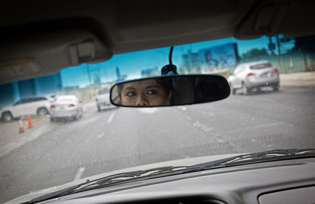In this June 28, 2017 photo, Riodoce reporter Miriam Ramirez drives to her office in Culiacan, Sinaloa state, Mexico. After the killing of Riodoce co-...