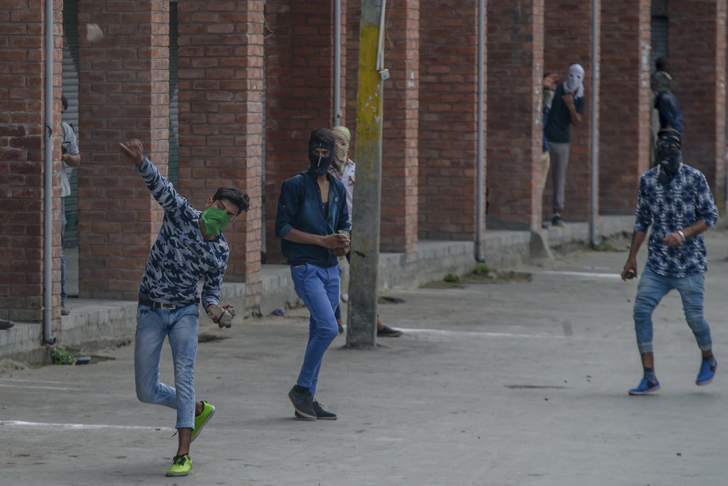 Kashmiri protesters clash with government forces, not pictured, during a protest in Srinagar, Indian controlled Kashmir, Friday, Aug. 4, 2017. Governm...