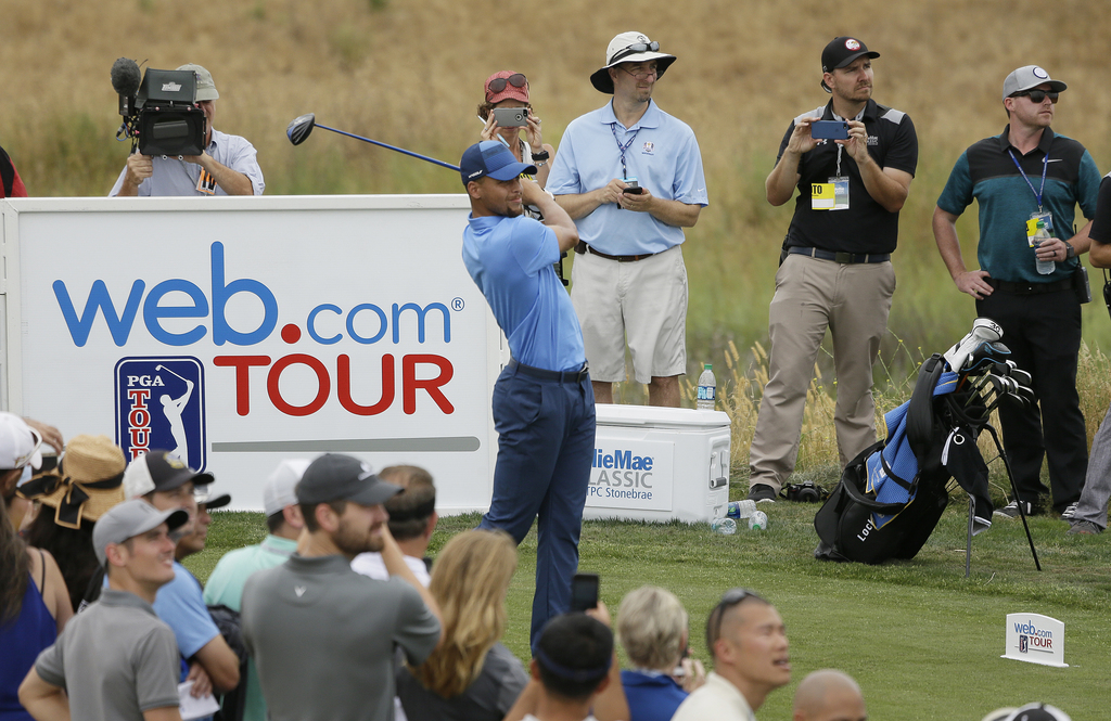 Golden State Warriors NBA basketball player Stephen Curry follows his drive from the ninth tee during the Web.com Tour's Ellie Mae Classic golf tourna...