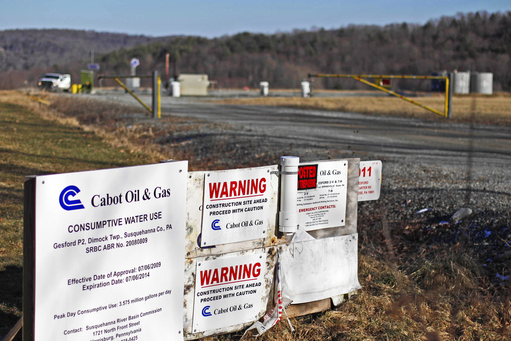 FILE – This Feb. 13, 2012, file photo shows a Cabot Oil & Gas Corp. wellhead in Dimock, Pa. Federal government scientists are collecting water and air...