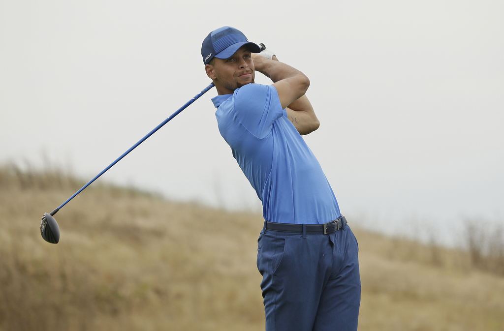 Golden State Warriors NBA basketball player Stephen Curry follows his drive from the 17th tee during the Web.com Tour's Ellie Mae Classic golf tournam...