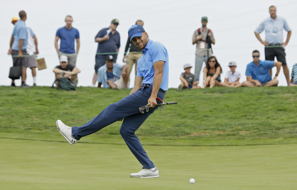 Golden State Warriors NBA basketball player Stephen Curry reacts after missing a birdie putt on the eighth green during the Web.com Tour's Ellie Mae C...