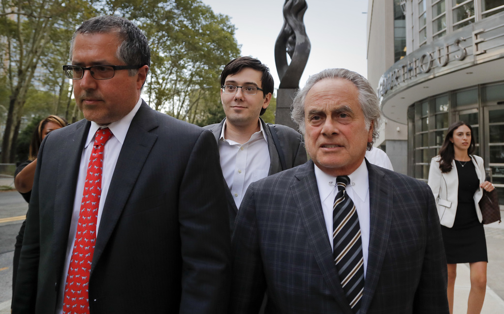 Former pharmaceutical company CEO Martin Shkreli, center, walks out of federal court with members of his legal team, Thursday, Aug. 3, 2017, in New Yo...