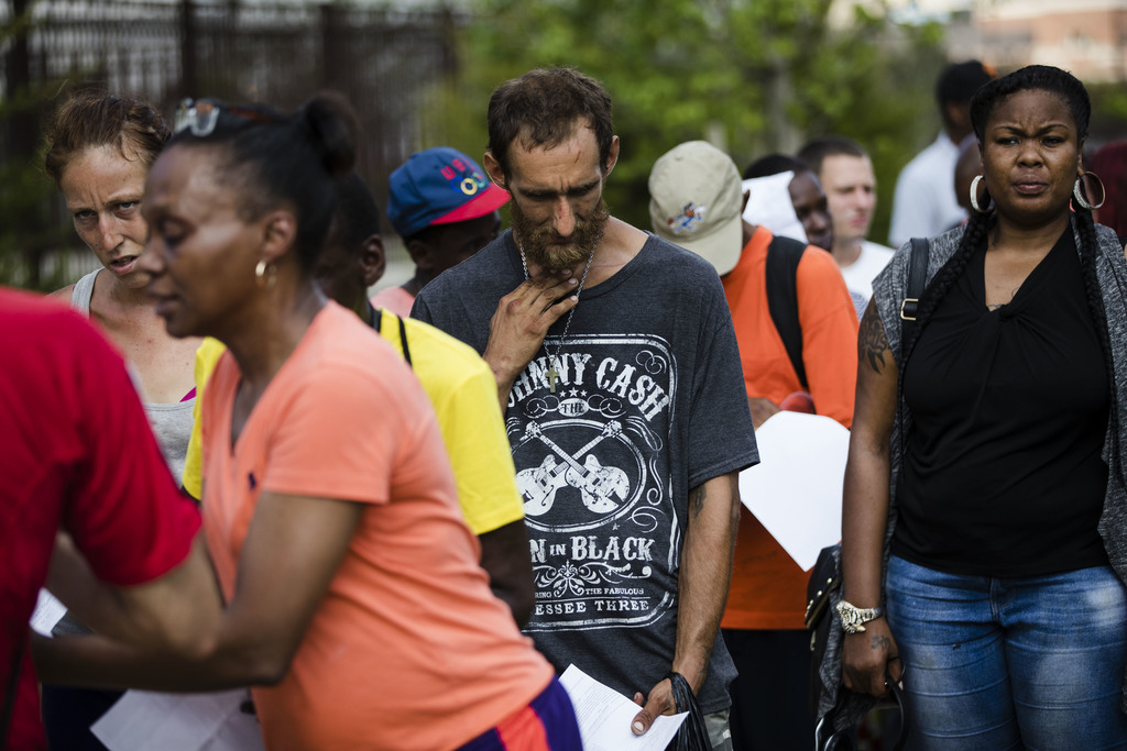 In this Monday, July 24, 2017 photo, Steven Kemp, who is addicted to heroin and is homeless, waits in line for help from a Philly Restart representati...