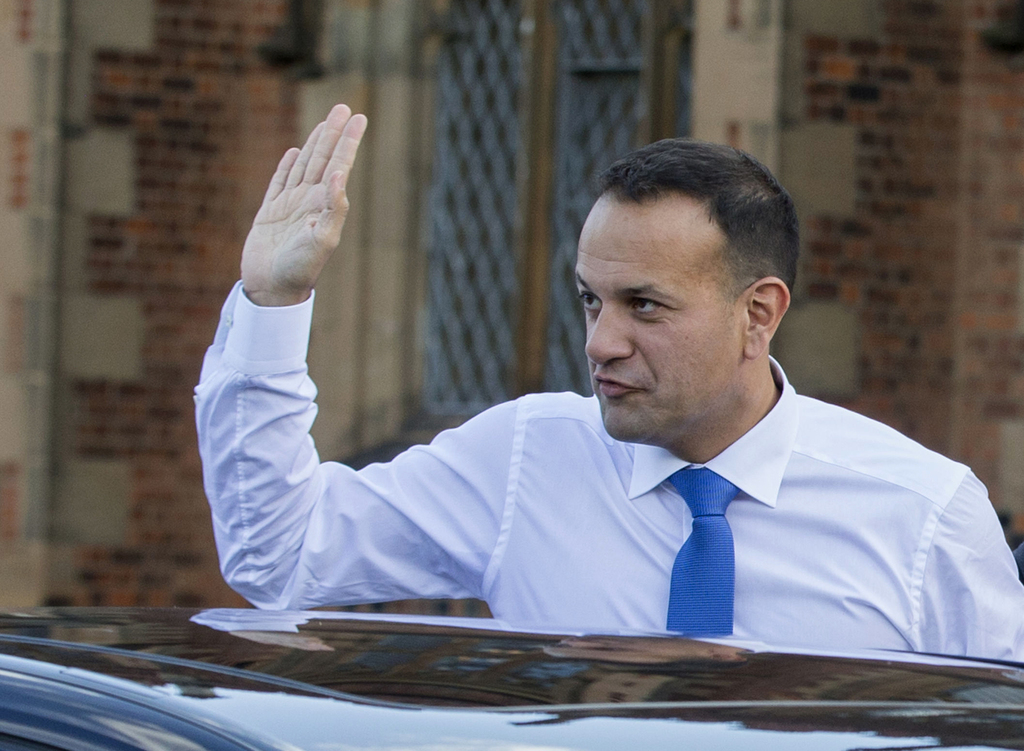 Irish Prime Minister Leo Varadkar waves as he arrives at the university in Belfast to make a speech on his first visit to Northern Ireland, Friday Aug...