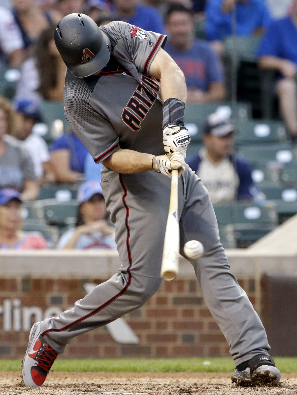 Arizona Diamondbacks' Paul Goldschmidt hits a solo home run against the Chicago Cubs during the ninth inning of a baseball game Thursday, Aug. 3, 2017...