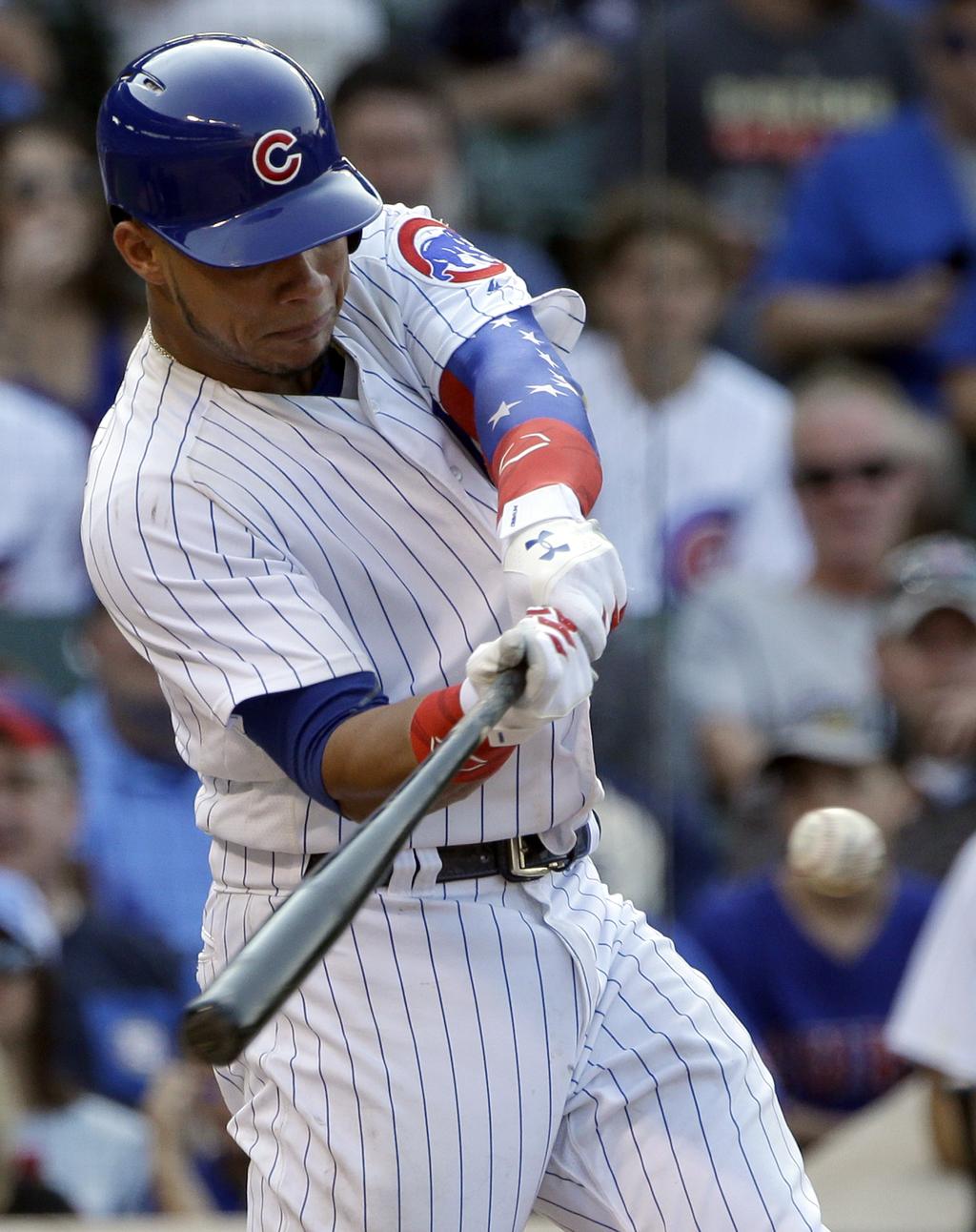 Chicago Cubs' Willson Contreras hits a three-run home run against the Arizona Diamondbacks during the sixth inning of a baseball game Thursday, Aug. 3...