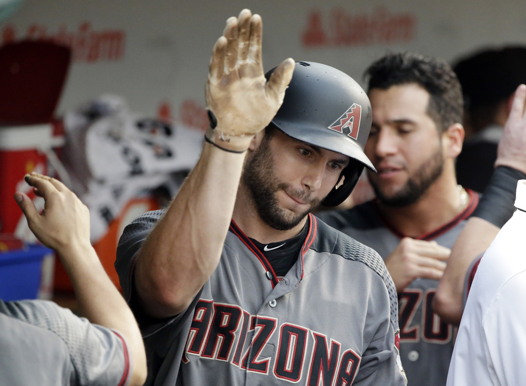 Arizona Diamondbacks' Paul Goldschmidt celebrates with teammates after hitting a solo home run against the Chicago Cubs during the ninth inning of a b...