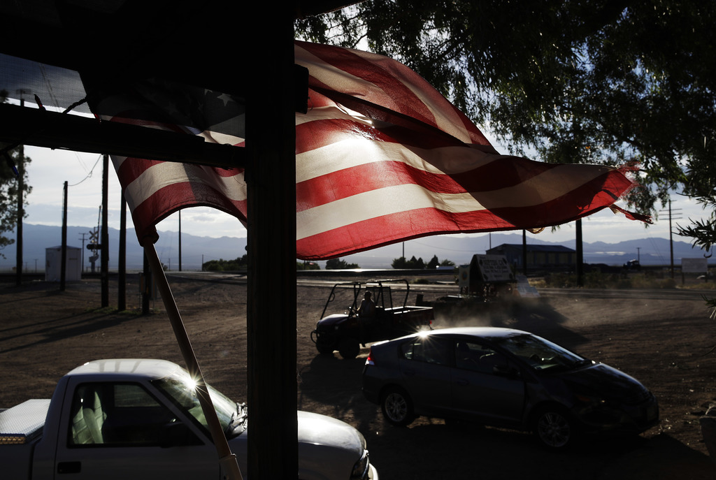 A flag flies in front of a store, Thursday, Aug. 3, 2017, in Nipton, Calif. American Green Inc., one of the nation's largest cannabis companies, annou...