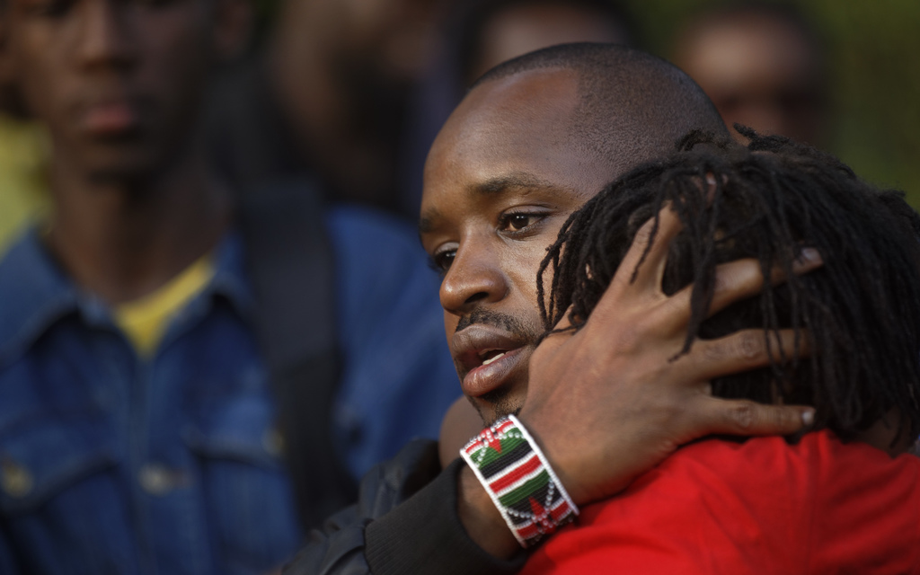 In this photo taken Saturday, July 29, 2017, former photojournalist, activist and now candidate for Member of Parliament Boniface Mwangi wears a wrist...