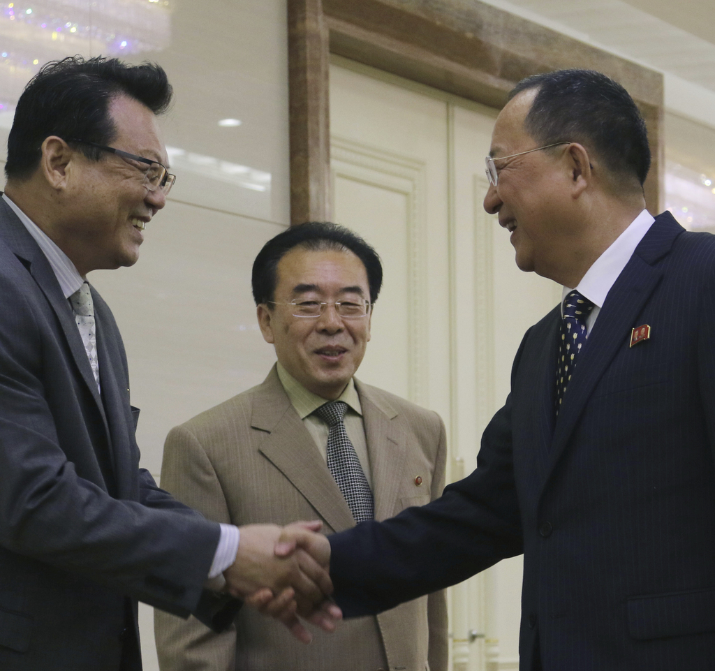 North Korean Foreign Minister Ri Yong Ho, right, shakes hands with Vice Foreign Minister Pak Myong Guk, left, before leaving for the Philippines to pa...